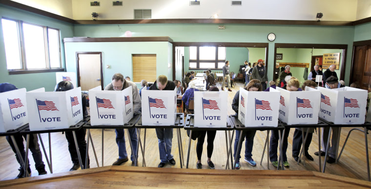 Image: Voters cast their ballots in Madison