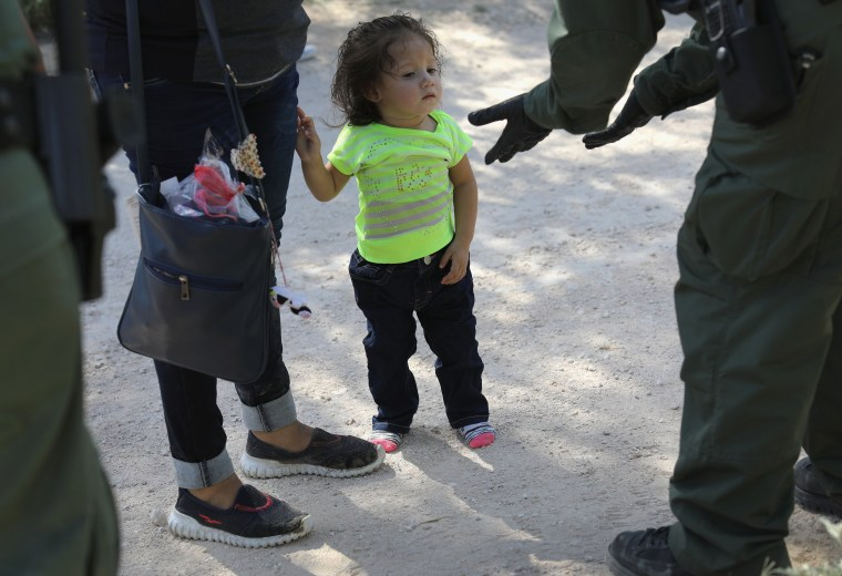 Image: Border Patrol Agents Detain Migrants