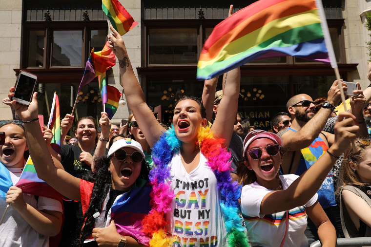Image: People cheer for marchers walking down 5th Avenue in the annual New York Gay Pride Parade