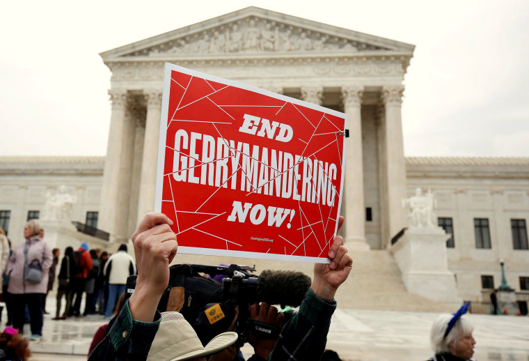 Image: Demonstrators rally in front of the Supreme court before oral arguments on Benisek v. Lamone in Washington