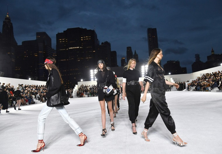 Image: Models walk the runway at the Alexander Wang Collection 1 show at Pier 17 in New York