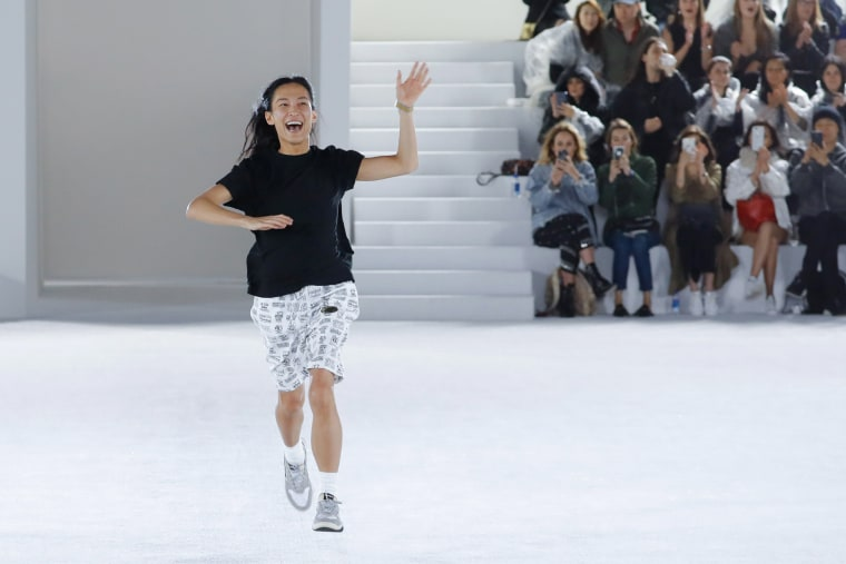 Image: Alexander Wang runs down the runway at the end of his show in New York