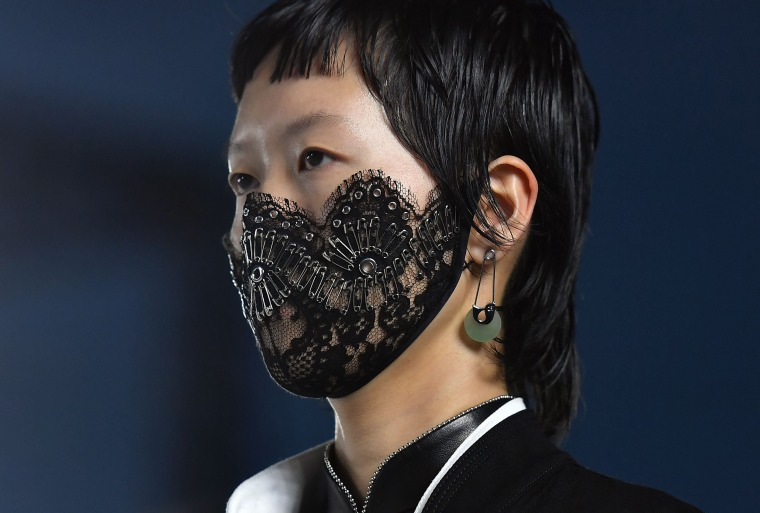 Image: A model wears a decorated surgical mask