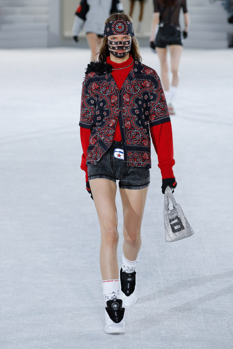 Image: A model walks the runway at the Alexander Wang Collection 1 show at Pier 17 in New York