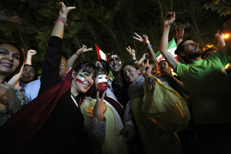 Image: Iranians celebrate their 1-0 victory against Morocco