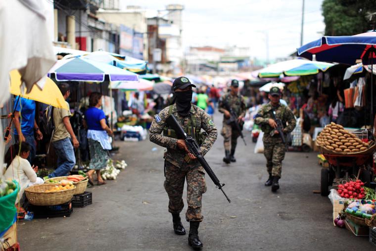 Image: Salvadoran soldiers patrol in downtown San Salvador after six market sellers were killed in San Salvador