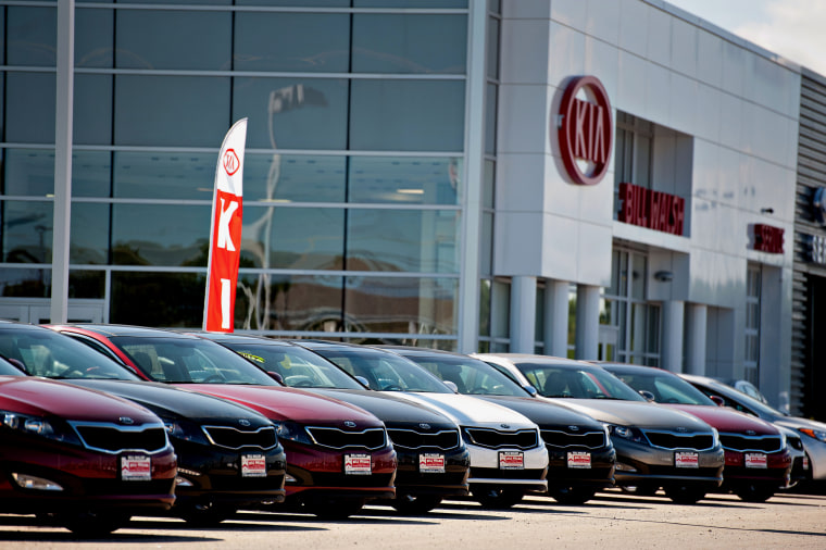Image: Kia Motors Corp. vehicles sit outside a Kia car dealership in Ottawa