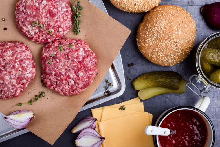 Image: Raw beef burger, buns and pickles