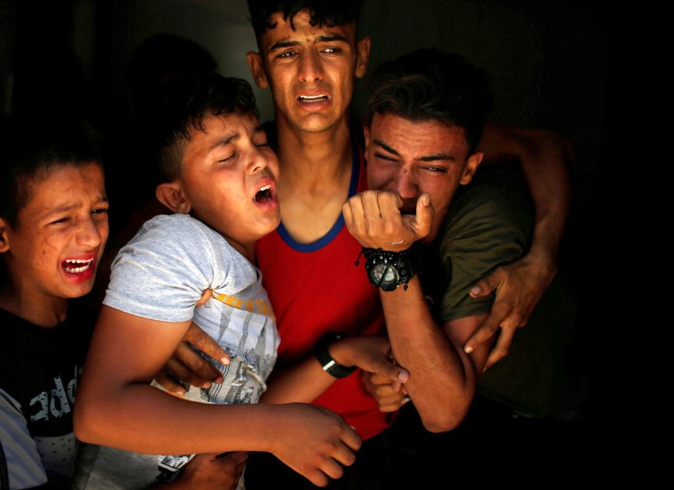 Image: Relatives of a Palestinian, who was killed at the Israel-Gaza border, react at a hospital in Gaza City