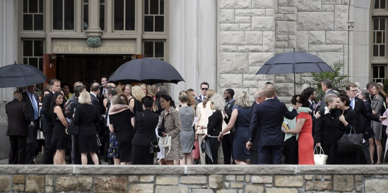 Image: Mourners for Kate Spade gather outside Our Lady of Perpetual Help Catholic Church