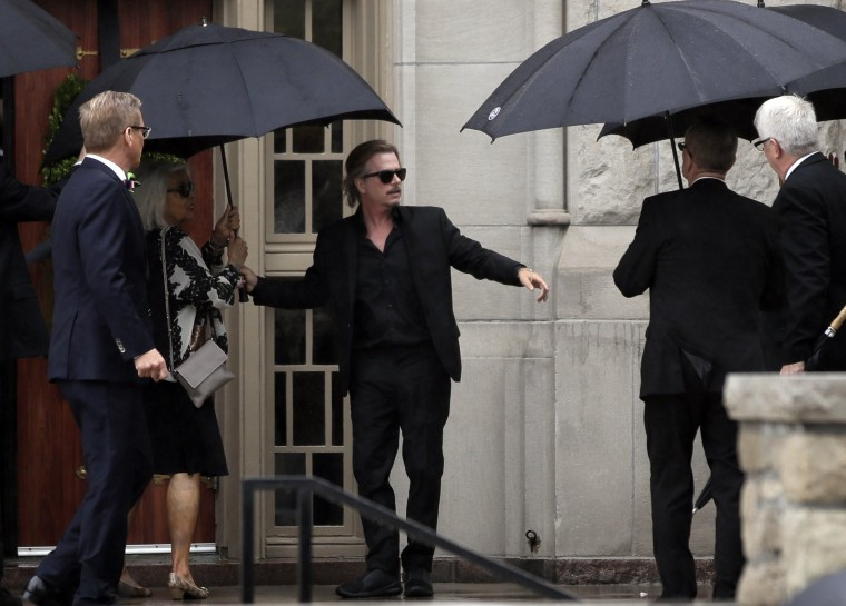 Image: David Spade helps family members enter Our Lady of Perpetual Help Redemptorist Catholic Church