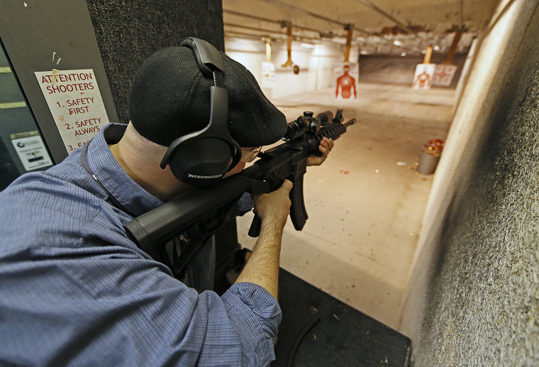 "Image: A man fires an 22 Cal. look-alike AR-15 rifle at the ""Get Some Guns & Ammo"" shooting range on January 15, 2013 in Salt Lake City, Utah."