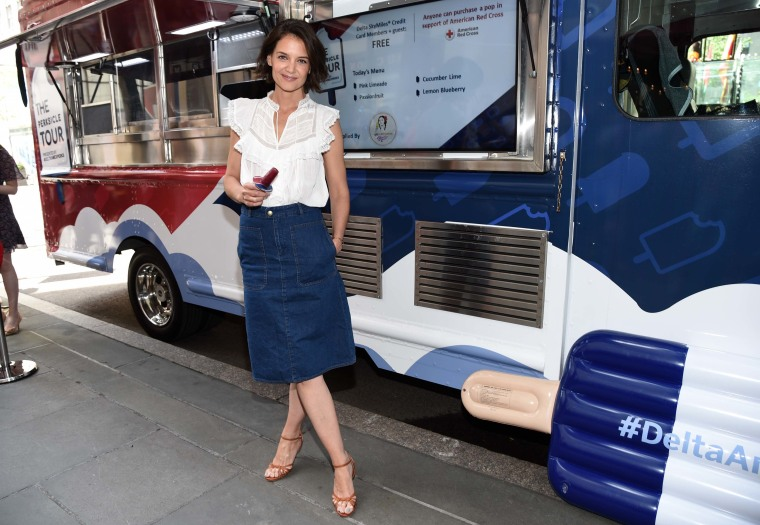 Katie Holmes kicking off summer with American Express and Delta.