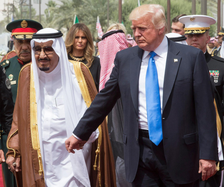 Image: President Donald J. Trump holds the hand of Saudi Arabia's King Salman bin Abdulaziz Al Saud