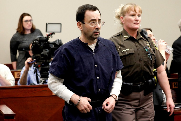 Image: Larry Nassar, a former team USA Gymnastics doctor, who pleaded guilty in November 2017 to sexual assault charges, is led from the courtroom after listening to victim testimony during his sentencing hearing in Lansing, Michigan