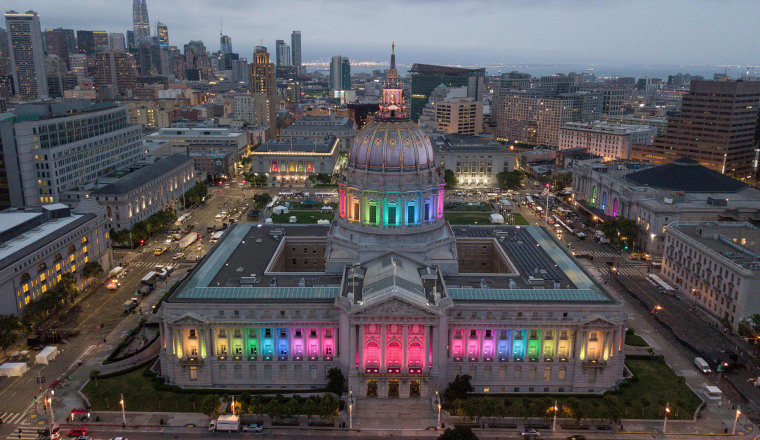 Image: San Francisco City Hall is lit up in rainbow colors following the Pride parade in San Francisco