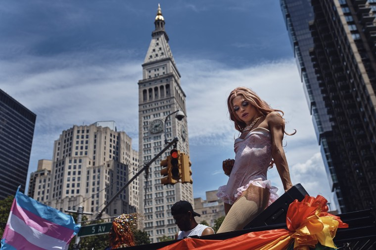 Image: A reveler performs as a float moves along Fifth Avenue during the New York City Pride parade
