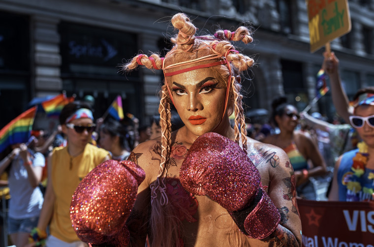 Image: A reveler pauses for a picture during the New York City Pride Parade