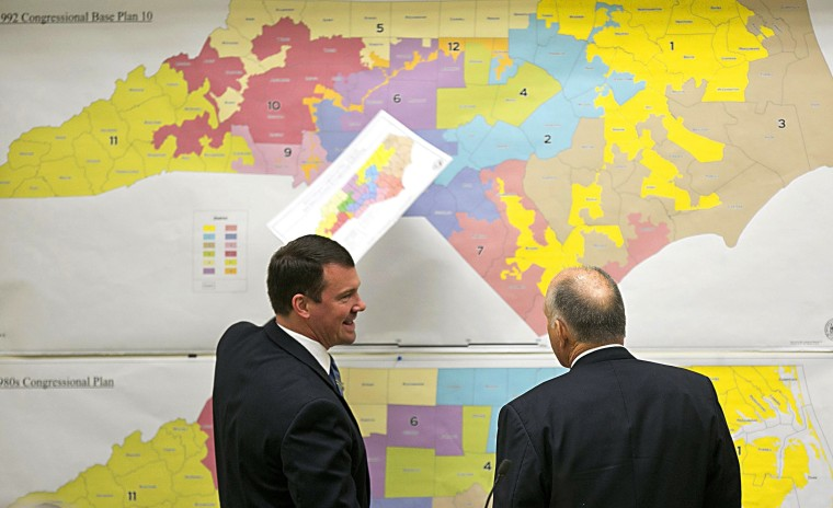 Republican state Sens. Dan Soucek, left, and Brent Jackson review historical maps during a meeting of the redistricting committee in 2016 in Raleigh, North Carolina.