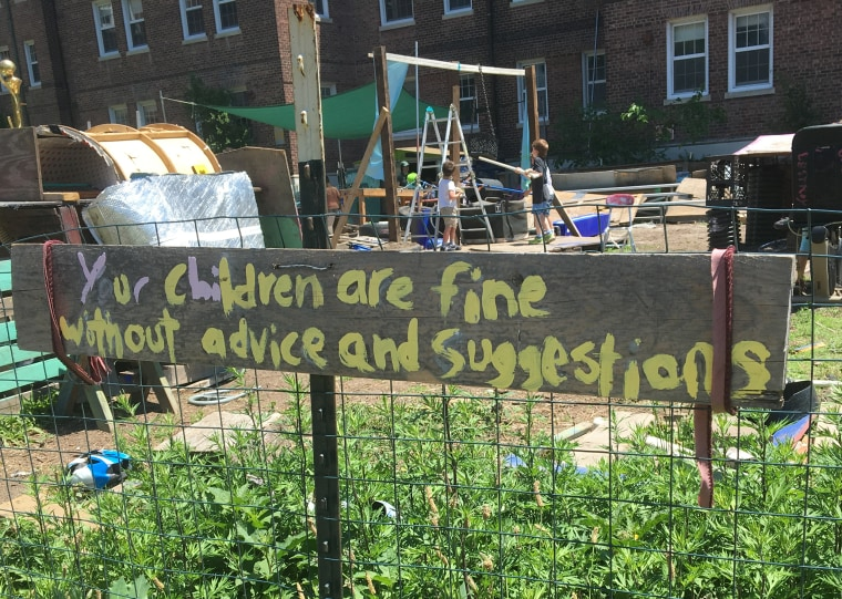 A sign at the adventure playground encourages parents not to intervene.