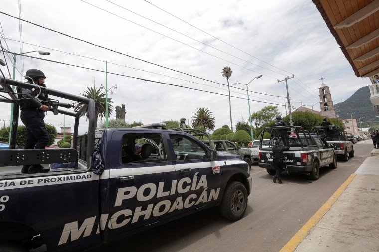 Image: Mexican police officers arrested on murder involvement suspicion