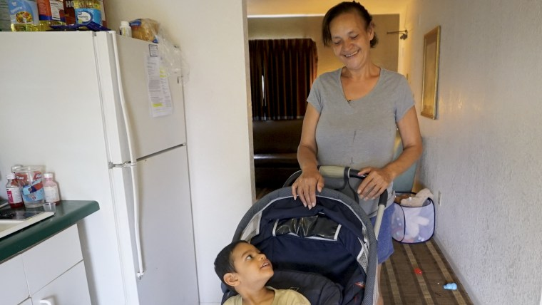 Maria Baez and Christian Dariel, a Puerto Rican family who was living in Florida under FEMA's Transitional Shelter Assistance program.