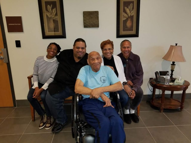 Kenneth Bowser (center) visits with (from left) grandchildren Tonya Cotton and Mark Cotton and daughters Sharon Van Leer and Janet Bowser at a locked forensic nursing home in St. Peter, Minnesota
