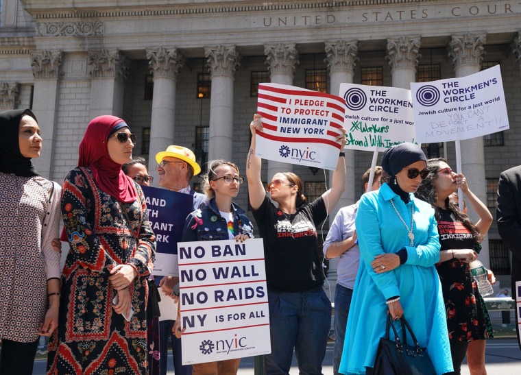 Members of the New York Immigration Coalition hold a news conference in Foley Square