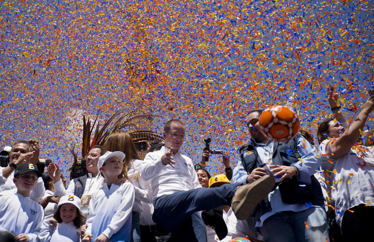 Image: Presidential candidate Ricardo Anaya kicks a soccer ball to supporters during a campaign rally