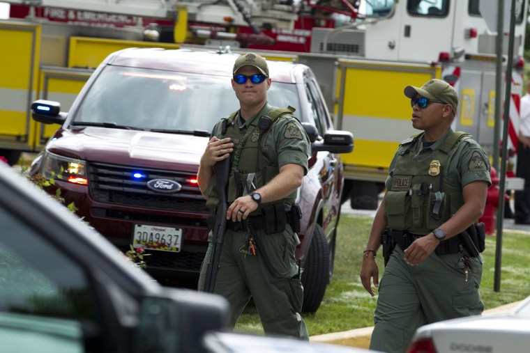 Image: Maryland police officers patrol the area after multiple people were shot at The Capital Gazette newspaper in Annapolis