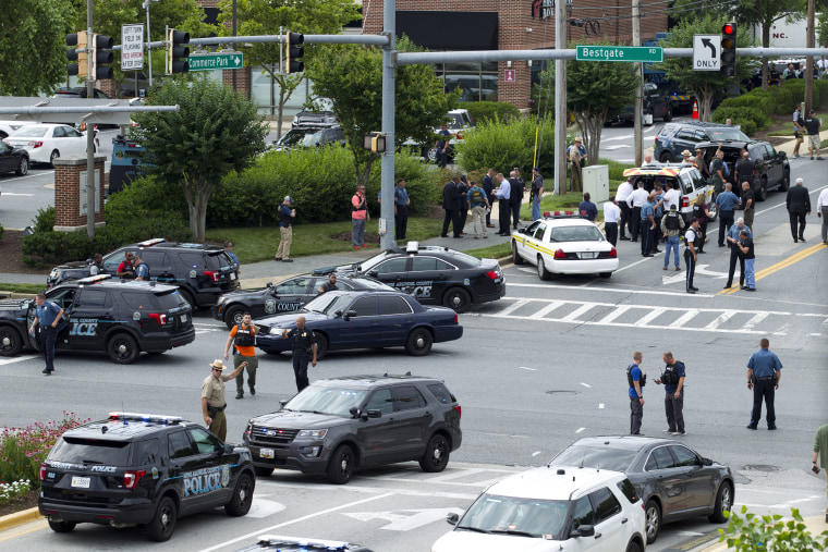 Image: Maryland police officers block the intersection at the building entrance
