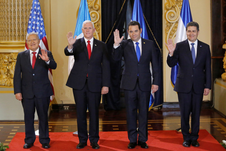 Image: El Salvador's President Sanchez Ceren, U.S. Vice President Pence, Guatemala's President Morales and Honduras' President Hernandez wave during a photo opportunity in Guatemala City