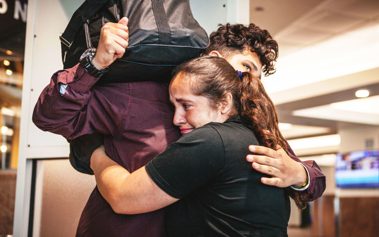 Jocelyn embraces her son James after nearly ten months of separation