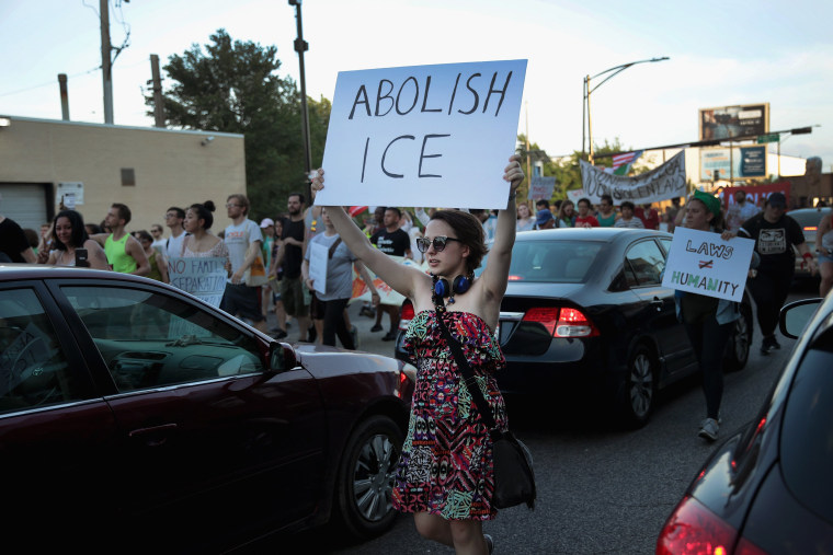 Image: Protestors In Chicago Rally Against Mass Detention Of Undocumented Immigrants