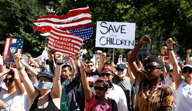 "Image: Demonstrators participate in ""Keep Families Together"" march to protest Trump administration's immigration policy in Manhattan New York"