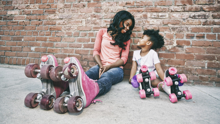 Mother and daughter wearing roller skates