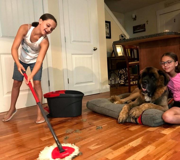 10-year-old Elena and Miranda mopping up muddy footprints