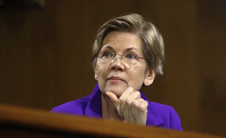 Image: Sen. Elizabeth Warren, D-Mass., listens during a hearing on Capitol Hill in Washington