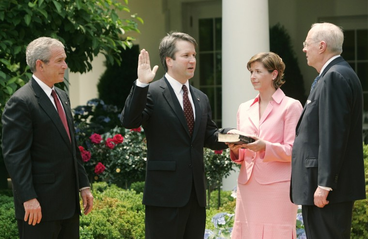 President Bush watches as Brett Kavanaugh is sworn in