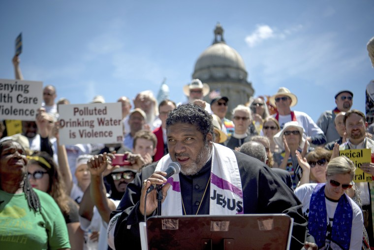 Image: Reverend William J. Barber speaks to protesters gathered during a protest organized by Kentucky Poor People's Campaign