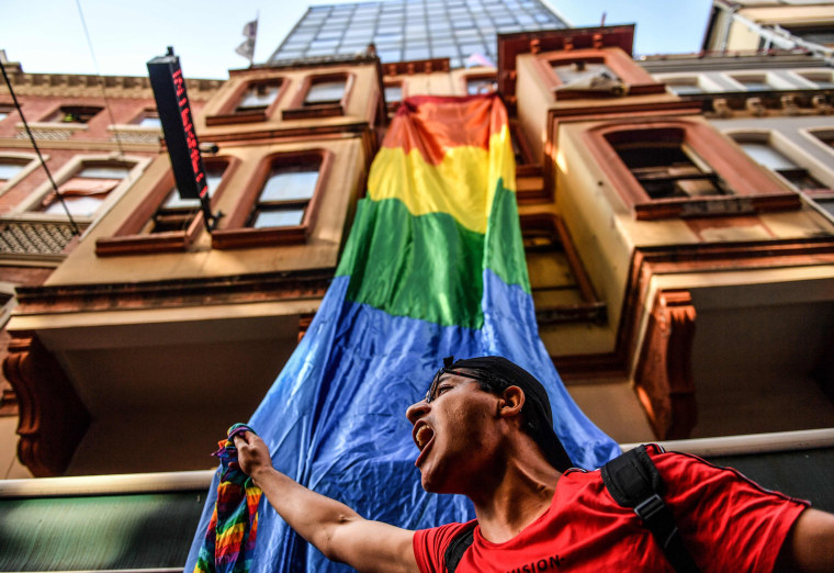 Image: A LGBT rights activist shouts during a march