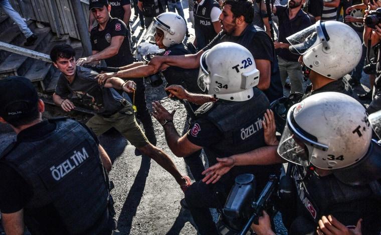 Image: Turkish riot policemen beats a LGBT rights activist