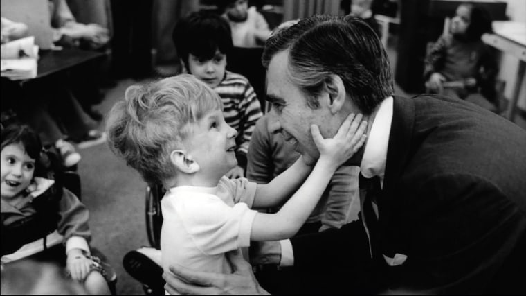 "Image: Fred Rogers meets with a disabled boy in the documentary movie ""Won't You Be My Neighbor?"""