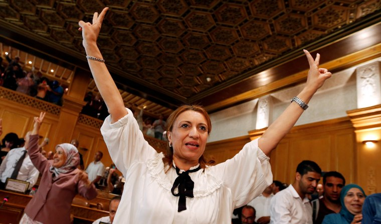 Image: Souad Abderrahim, a candidate of the Islamist Ennahda party celebrates after being elected mayor of the city of Tunis