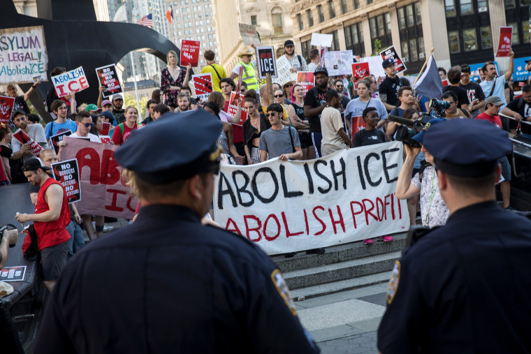 Image: Activists march and rally against Immigration and Customs Enforcement