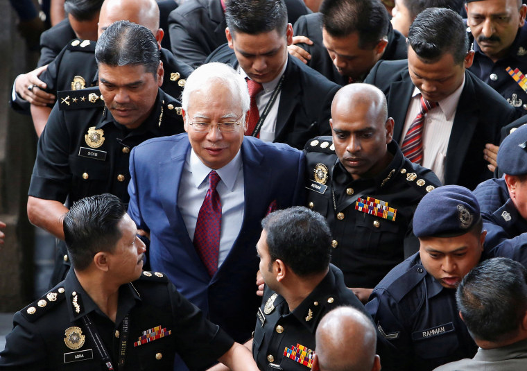 Image: Former Malaysian prime minister Najib Razak arrives in court in Kuala Lumpur
