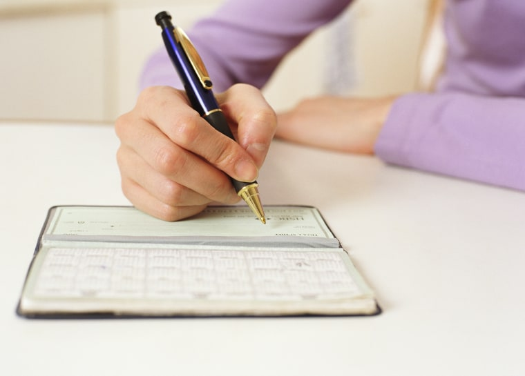 Image: Writing in checkbook