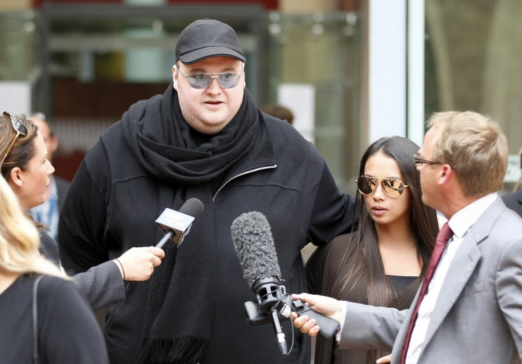 Image: Megaupload founder Kim Dotcom talks to members of the media as he leaves the High Court in Auckland