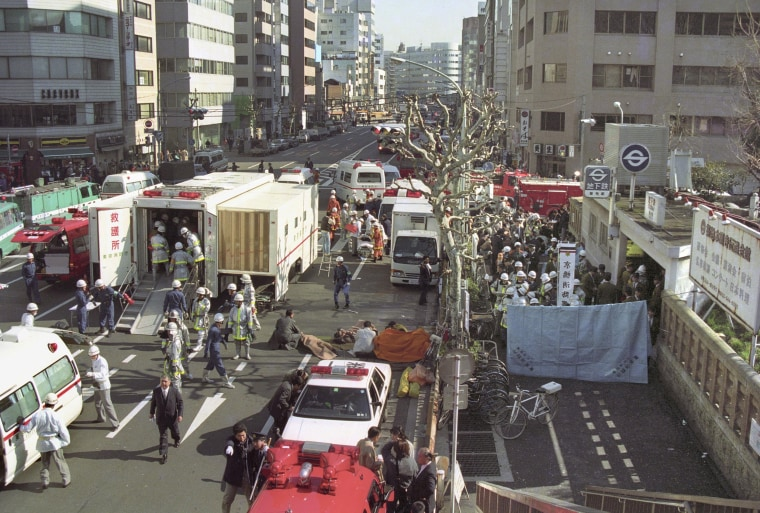 Image: The injured of the deadly gas attack are treated by rescue workers near Tsukiji subway station in Tokyo