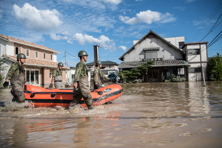 At least 94 people killed in torrential rains, landslides ...